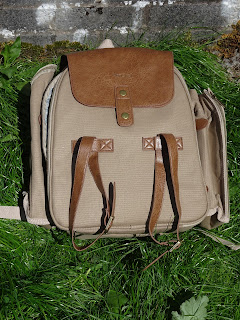 tweed bag on green grass