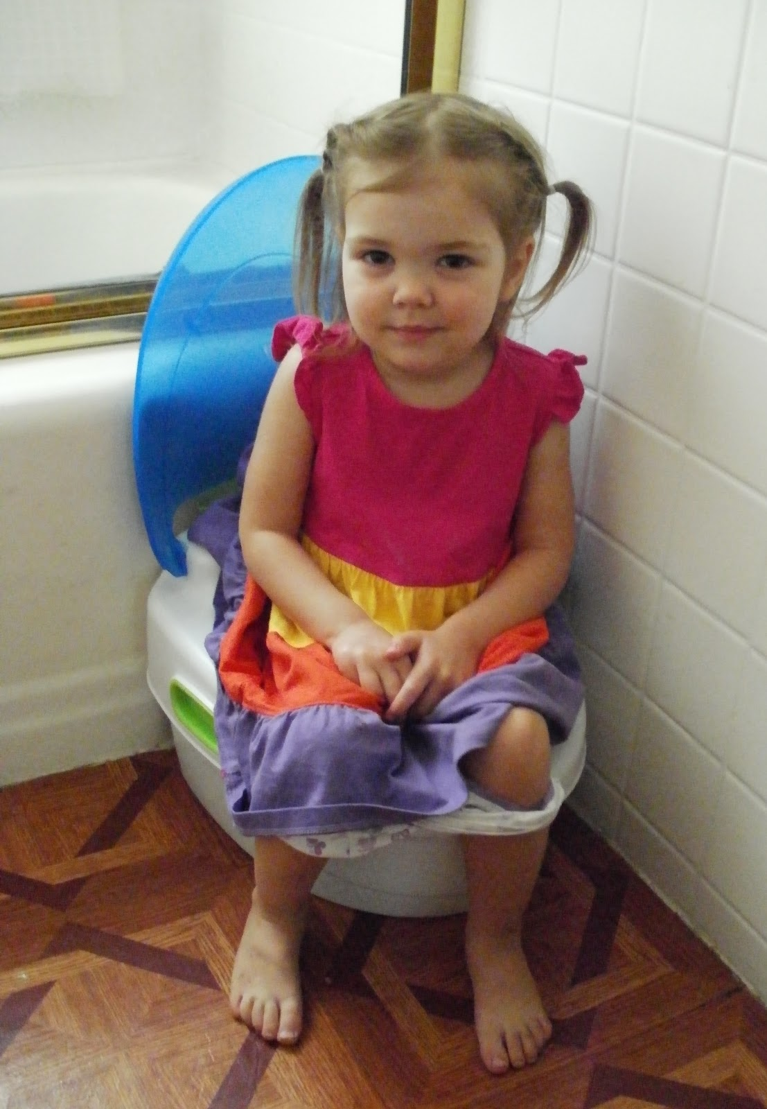 little girl potty wiping