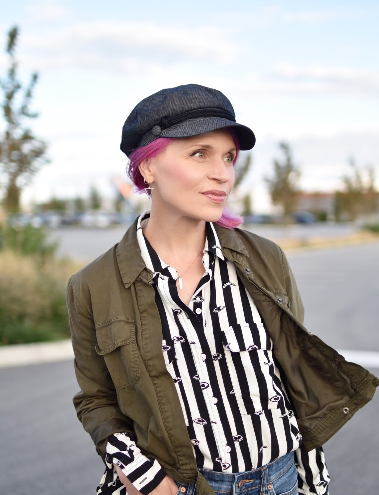 Monika Faulkner outfit inspiration - black-and-white striped shirt, olive cargo jacket, baker boy hat
