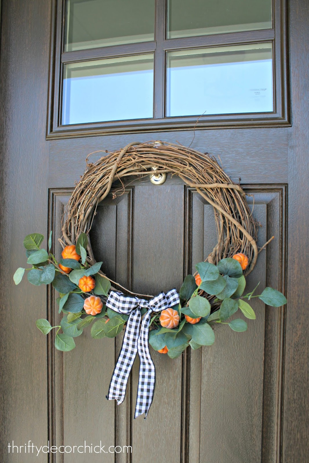 Simple fall wreath with pumpkins and eucalyptus