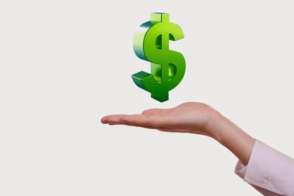 Photo of an open hand with an illustrated green dollar sign above it