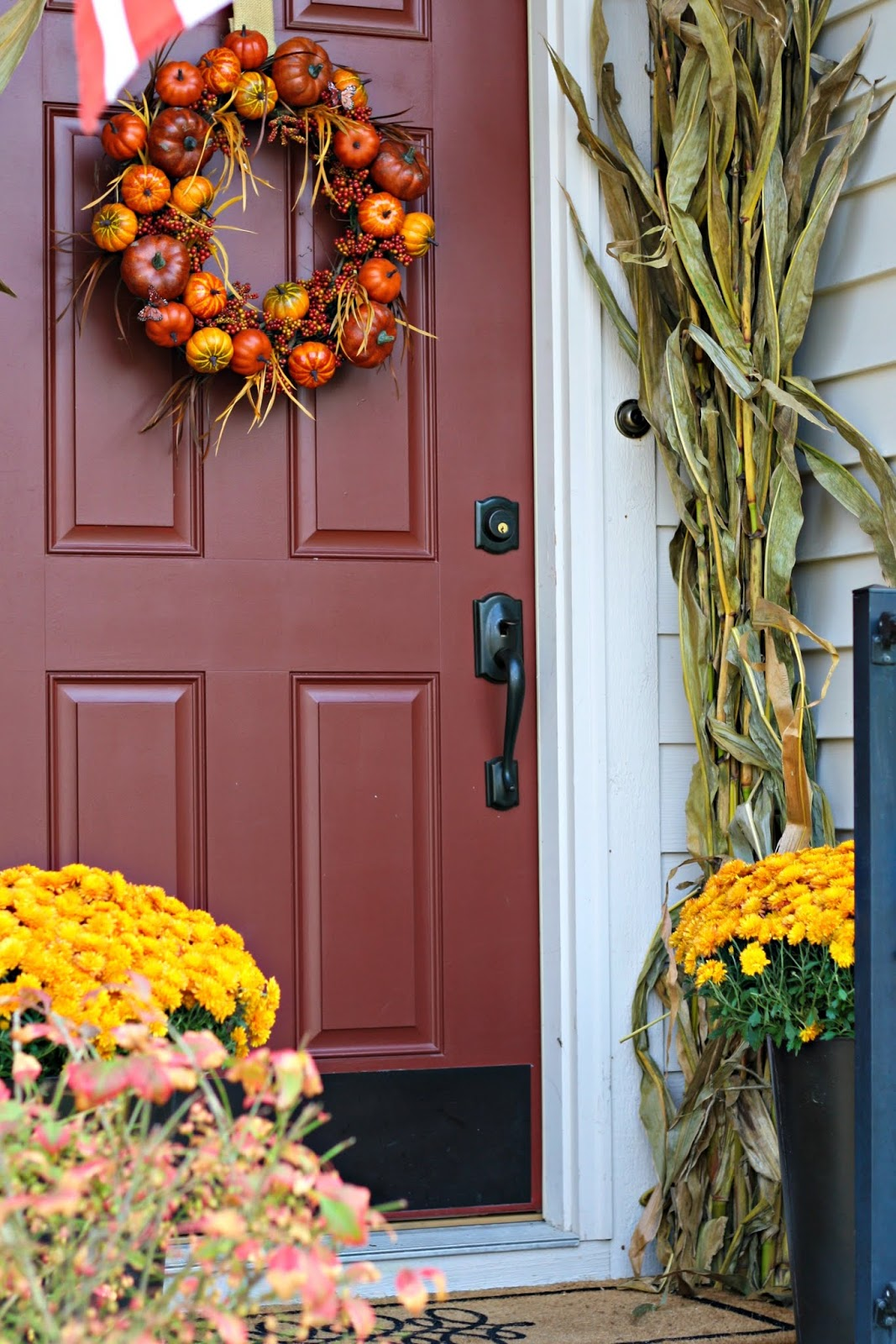 DIY fall pumpkin wreath with grapevine