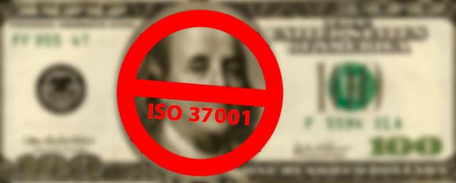 dinero con un grafismo de prohibicion y la ISO 37001