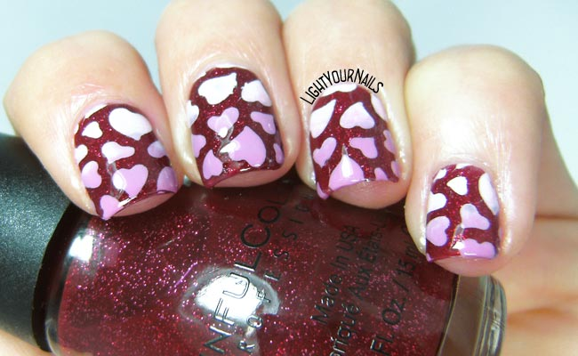 Pink gradient hearts over glitter red nail art