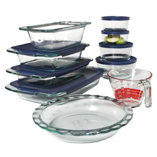 A set of glass containers with plastic lids, that could be used for cooking or prepping and storing food.