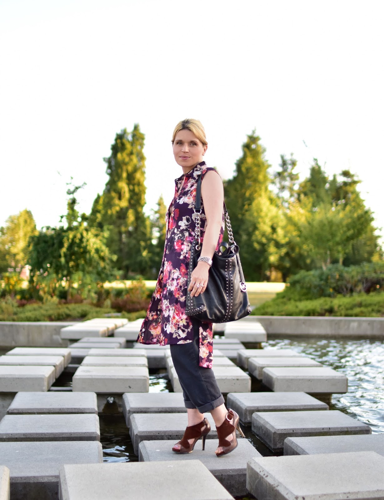 Monika Faulkner styles a floral tunic-style blouse with boyfriend trousers and open-toe stiletto shoes