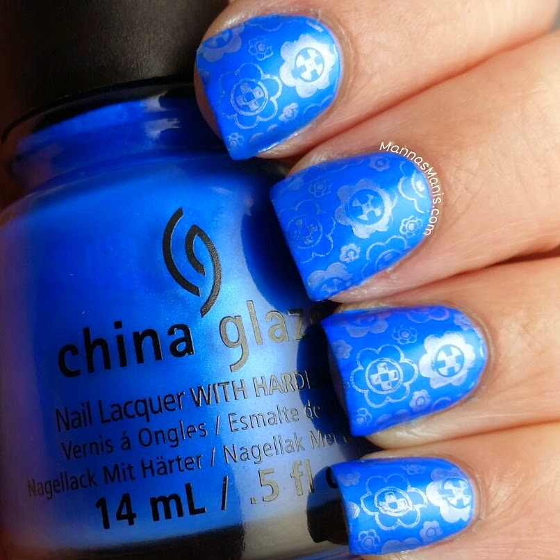 blue nail polish with silver nail stamping