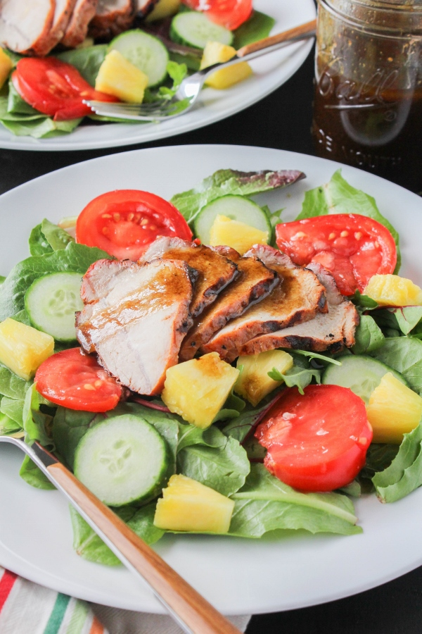 Juicy and flavorful pork, fresh pineapple and heirloom tomatoes are topped with a simple vinaigrette to create a hearty summer salad that the whole family will love!