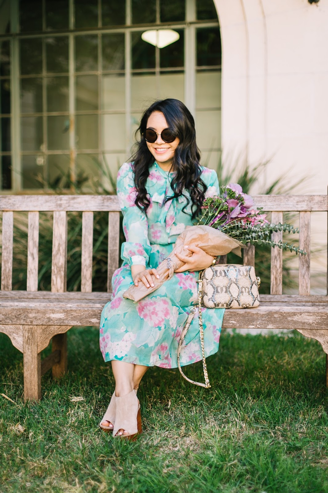 round sunglasses and vintage floral dress