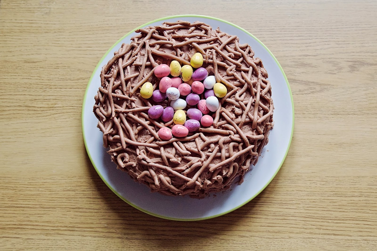 Birdseye View of the Easter nest cake with mini eggs in the centre.