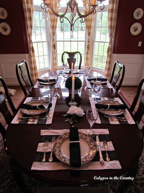 Black and White Table Setting in Red Dining Room