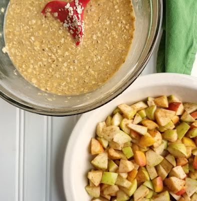 bowl of oatmeal mixture next to pie plate with apple chunks in it