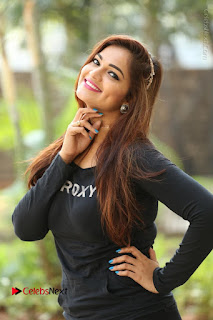 Actress Aswini Latest Stills in Black Denim Jeans  0111.JPG