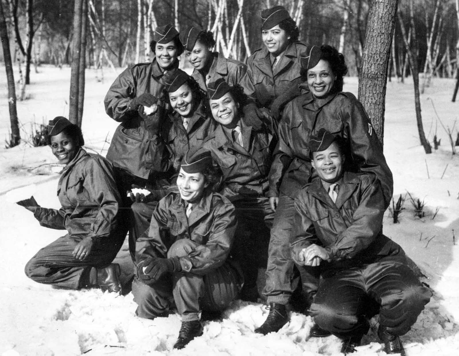 Members of the Women's Army Corps (WAC) pose at Camp Shanks, New York, before leaving from New York Port of Embarkation on February 2, 1945. The women are with the first contingent of Black American WACs to go overseas for the war effort From left to right are, kneeling: Pvt. Rose Stone; Pvt. Virginia Blake; and Pfc. Marie B. Gillisspie. Second row: Pvt. Genevieve Marshall; T/5 Fanny L. Talbert; and Cpl. Callie K. Smith. Third row: Pvt. Gladys Schuster Carter; T/4 Evelyn C. Martin; and Pfc. Theodora Palmer.