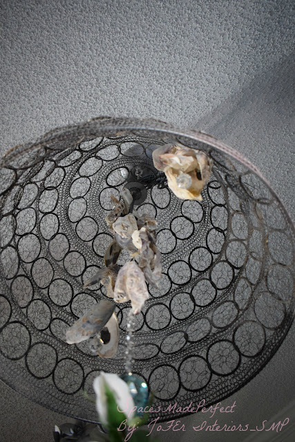 Vintage chandelier decorated with Crystals and oyster shells