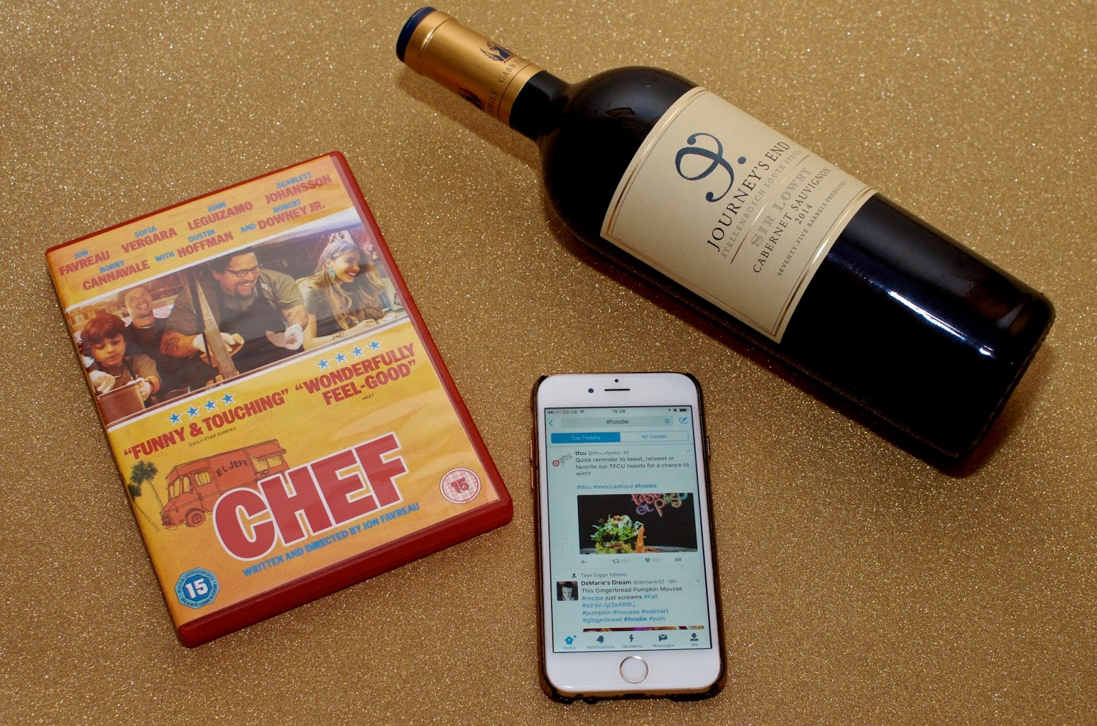 Chef DVD, bottle of wine and iPhone 6