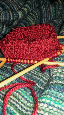 knitting small red hats for Little Hats, Big Hearts program; American Heart Association