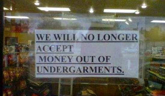 Funny African shop sign - we will no longer accept money out of undergarments joke picture