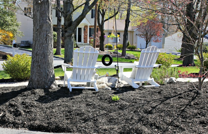 Seating area created in front of house with Adirondack chairs - www.goldenboysandme.com