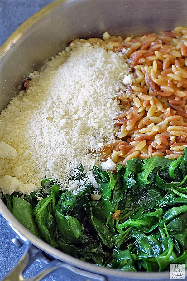 Add the spinach back in the skillet with the orzo and Parmesan cheese
