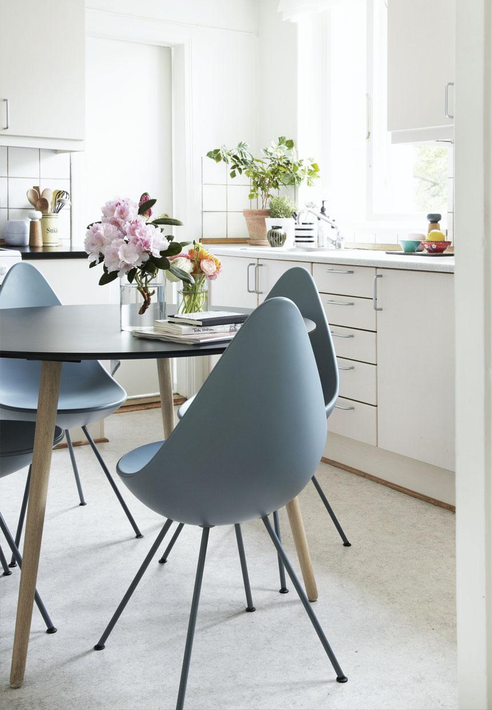 scandinavian apartment kitchen decor, white kitchen cabinets,flowers decor,