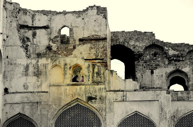 a couple in ruins of golconda fort