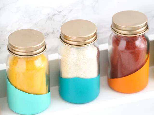 DIY Colorblocked and Gold Topped Spice Jars to help you organize and beautify your pantry or spice rack.
