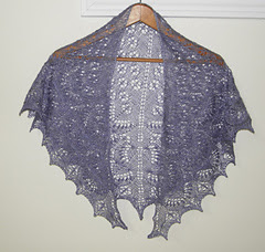crescent shaped shawl with an all over lace pattern; knitting, hand knit