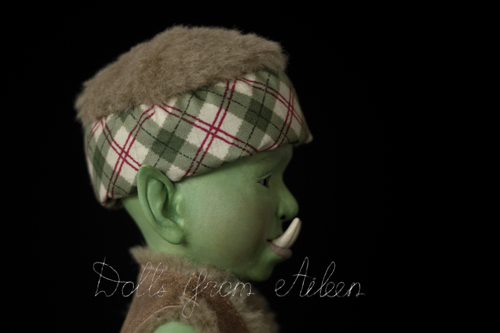 ooak artist baby orc doll's face in profile