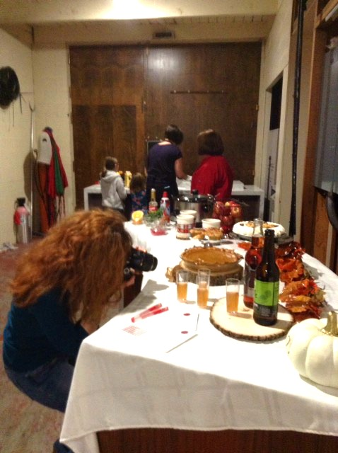 Fizzy Party capturing pics of her Friendsgiving table for her tv segment