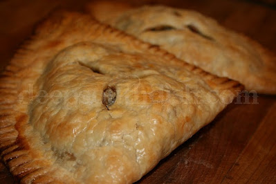 Delicious Natchitoches Meat Pies are filled with a combination of ground beef and pork and nicely seasoned with onions, sweet peppers, garlic, cayenne and pepper sauce.