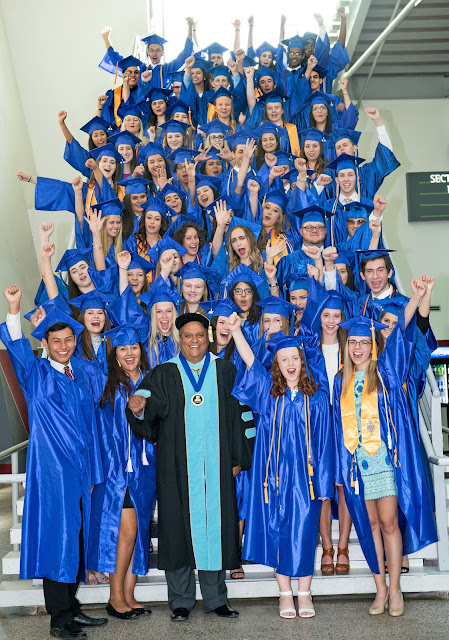 image of Rio Salado Dual Enrollment Students with President Dr. Bustamante in caps and gowns celebrating
