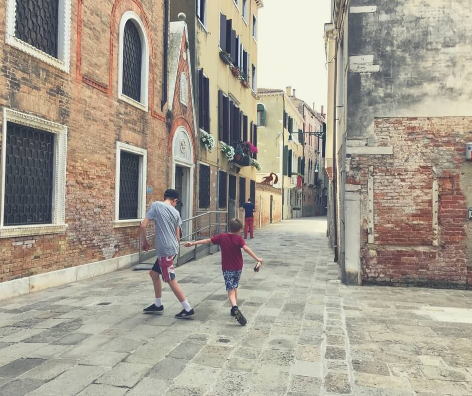 boys playing in the streets of Venice, Italy