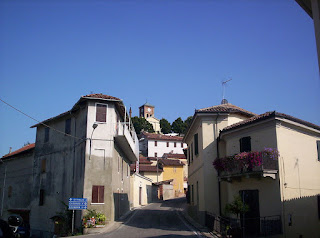 The hilltop village of Grazzano Badoglio, with the former Abbey of Aleramica visible at the top