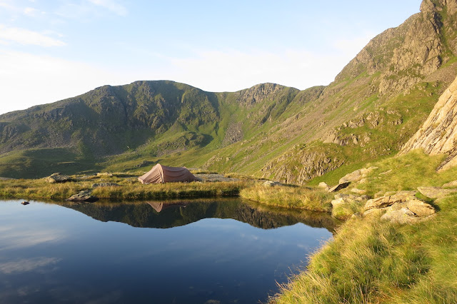 A perfect spot for a wild camp - my tent pitched next to Hard Tarn, Lake District Stunning views of the surrounding Lake District mountain range from Hard Tarn