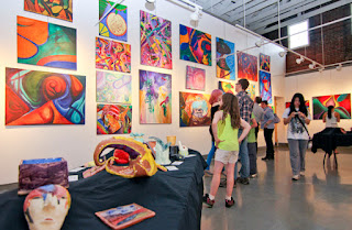 Visitors engaged in the work of an Artist showcased in a Art show organized by Corporate Event Organizer KIyoh