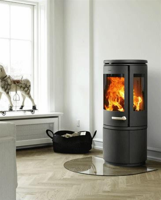 The Gl Hearth Mirrors Curves Of Circular Wood Burner