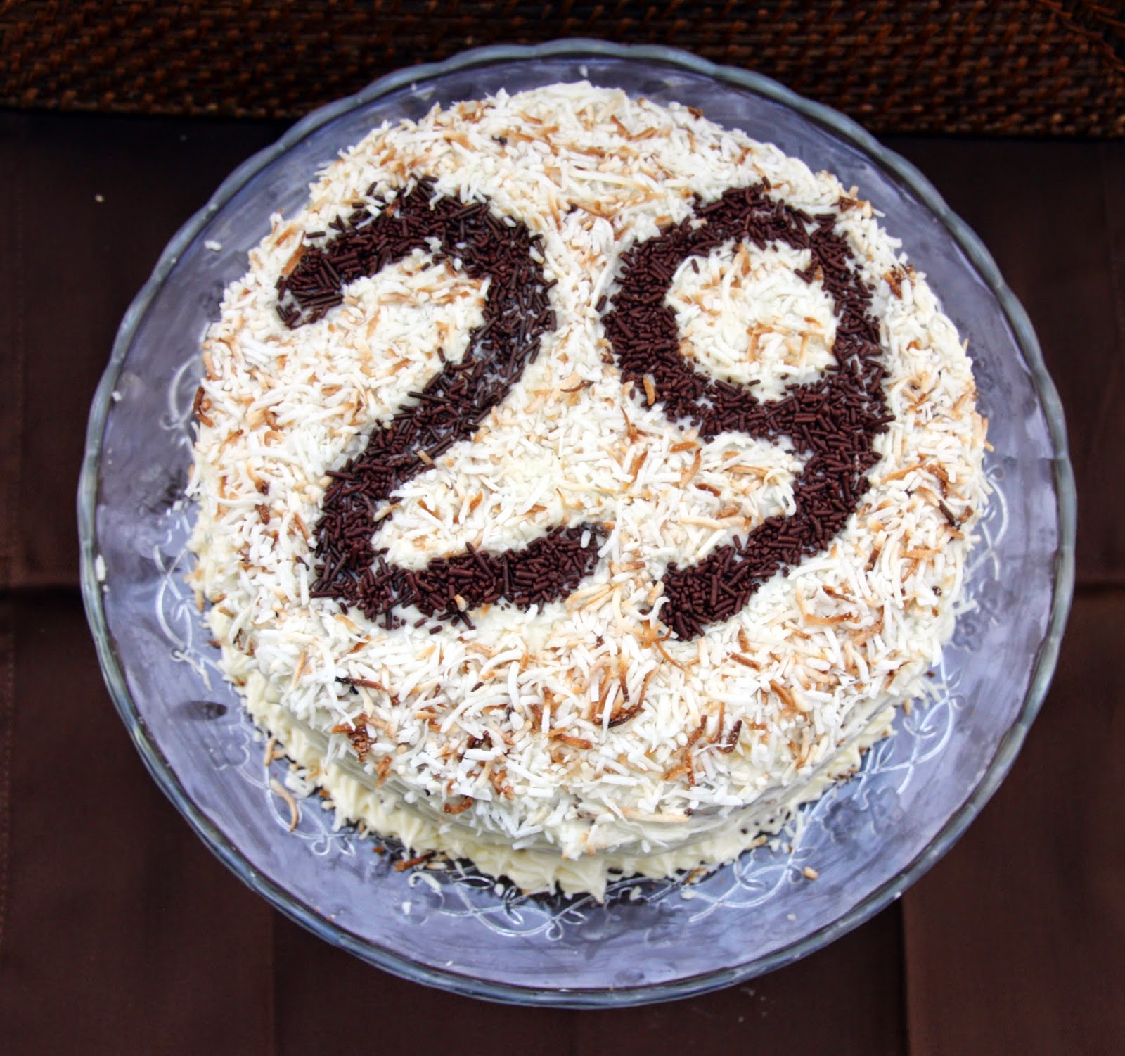 carrot cake with birthday numbers with sprinkles