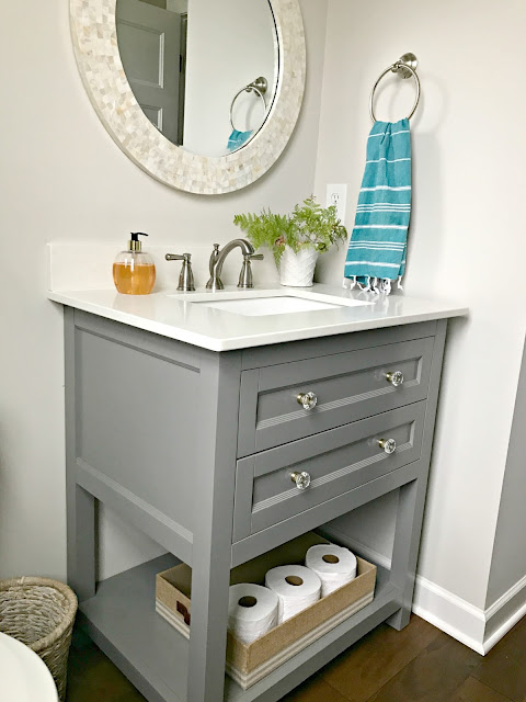 small vanity with drawers and open shelf