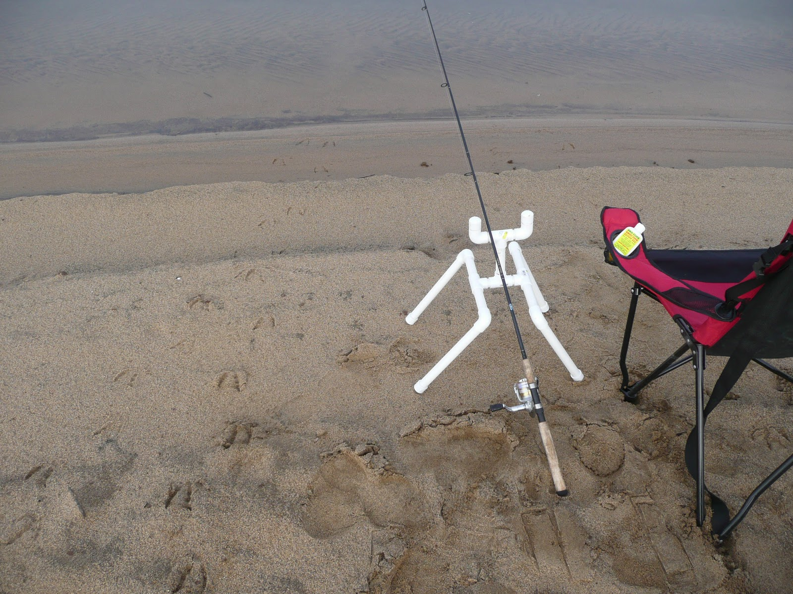 fishing chair with pole holder zero gravity hanging northern california trout rod