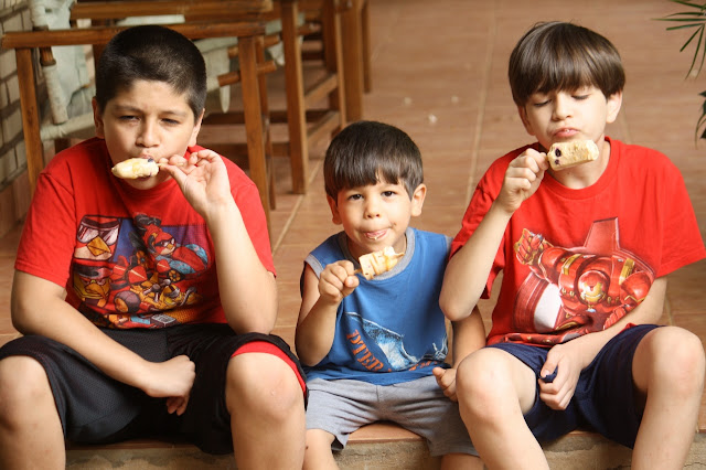 boys eating Dulce de Leche Banana Popsicles