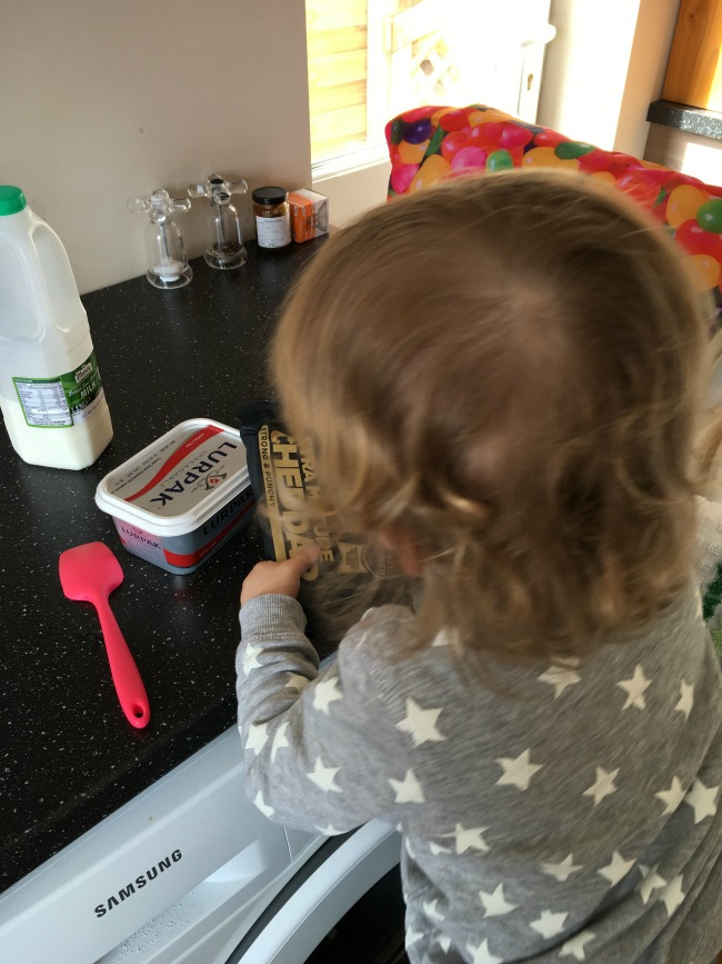 Making Macaroni Cheese With A Toddler - Recipe. toddler looking at cheese packet