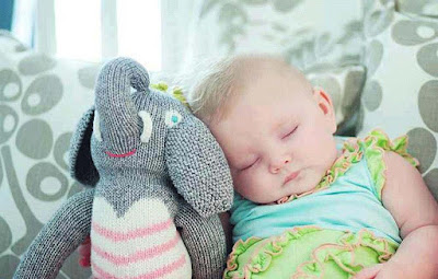 sleeping-baby-with-his-toy-walls-pics