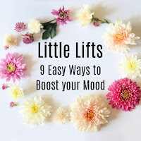 A ring of pastel coloured flowers, containing the title text 9 Ways to Boost Your Mood.