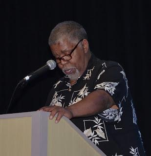 Charles Seabe Banks reads aaduna gala 2018 Auburn NY