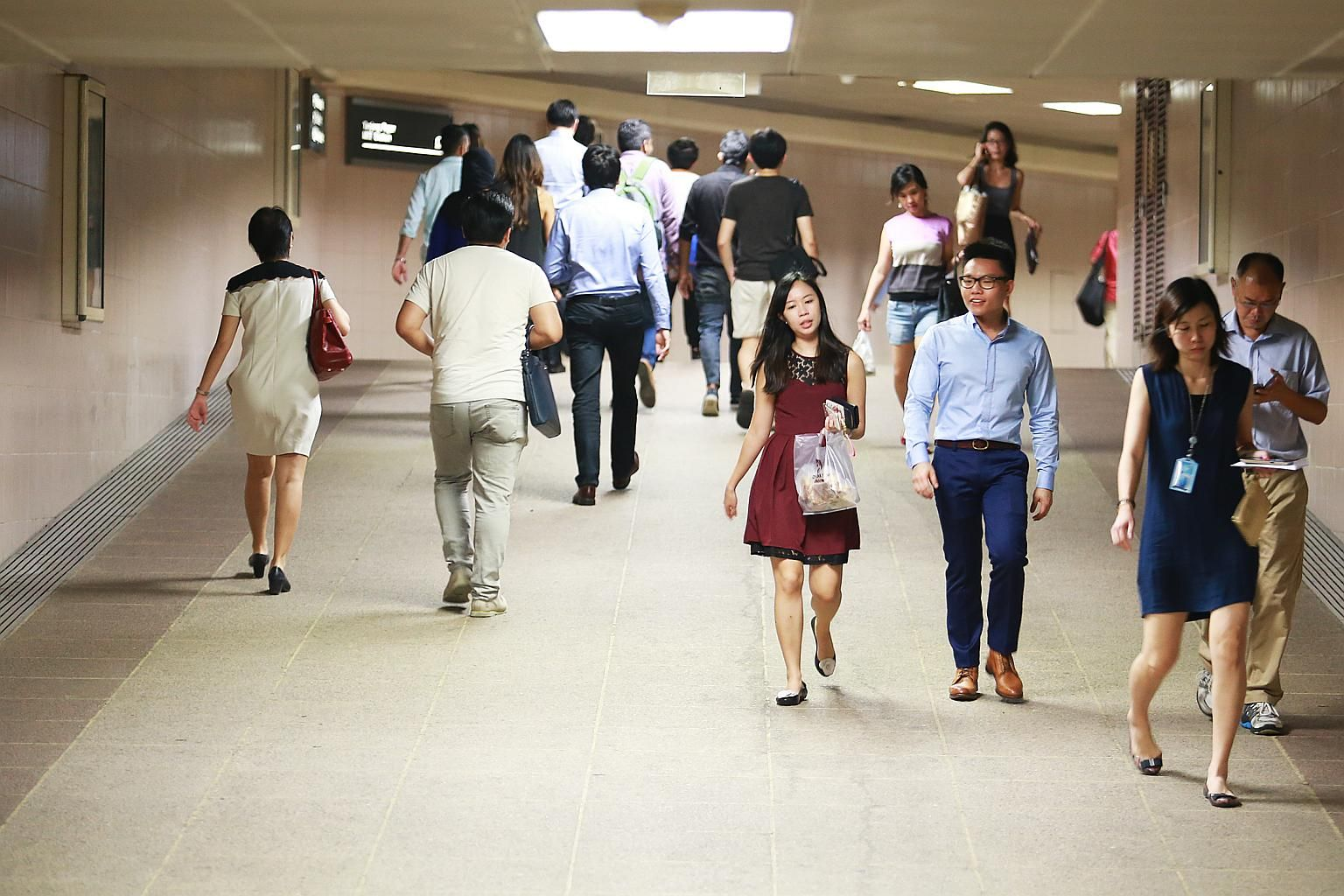 The Ministry of Manpower (MOM), which has been reiterating in recent months that it's watching closely the economic and labour market situation, on Tuesday warned it will cut the work pass privileges of employers who unfairly retrench Singaporeans.