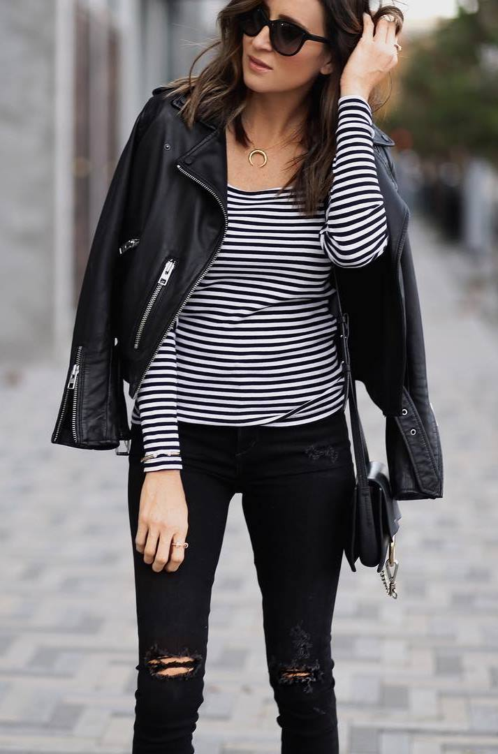 how to style a biker jacket : striped top + bag + black skinnies