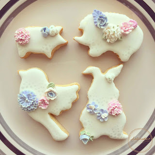 animal cookies with piped flower and ruffles in natural food colourings
