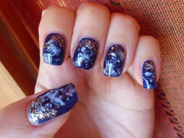 manicura galaxias dorada