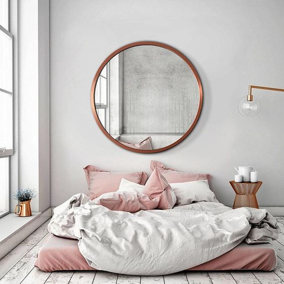 Large Round Mirror Above Bed